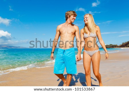 Attractive Couple Walking on Beautiful Beach