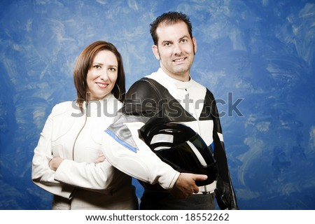 Attractive couple wearing high-end motorcycle gear - stock photo