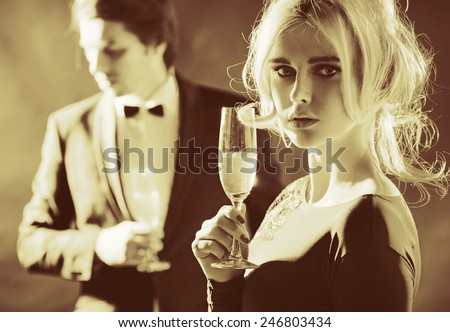 Attractive couple with glasses of champagne - stock photo