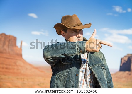 attractive cow boy in famous Monument valley National tribal park, USA