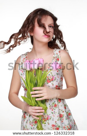 Attractive cute beautiful girl wearing clothes with floral ornament on Holiday theme - stock photo