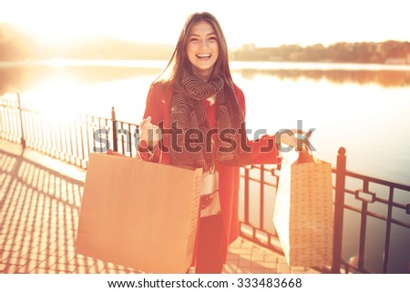 Attractive cute girl in with the shopping bags in her hands - stock photo