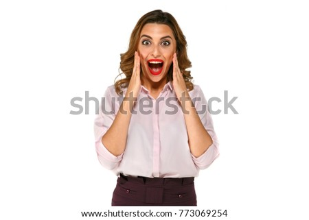 Attractive cute smiling funny woman, very excited, surprised, feels happiness with both of hands raised up and red lipstick isolated on white background