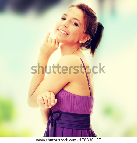 Attractive dancer girl in violet classic dress