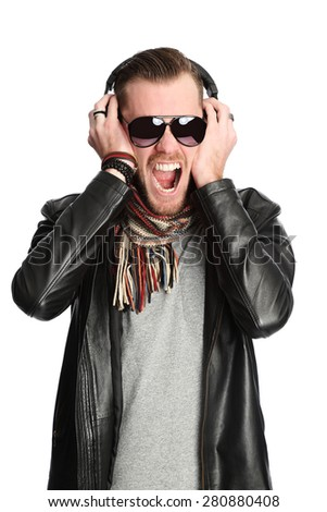 Attractive DJ wearing a black leather jacket and sunglasses. White background. - stock photo