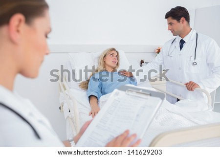 Attractive doctor taking care of a hospitalized patient