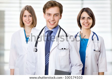 Attractive doctor with his young colleagues