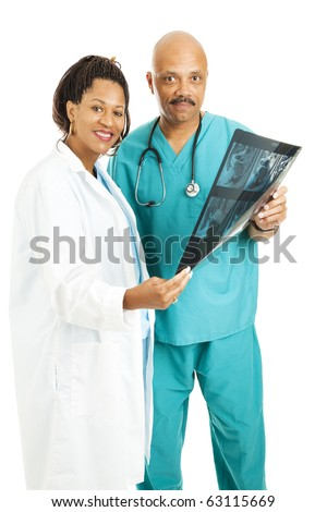 Attractive doctors holding a CT scan.  Isolated on white.