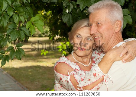 Attractive elderly couple went for a walk in the park
