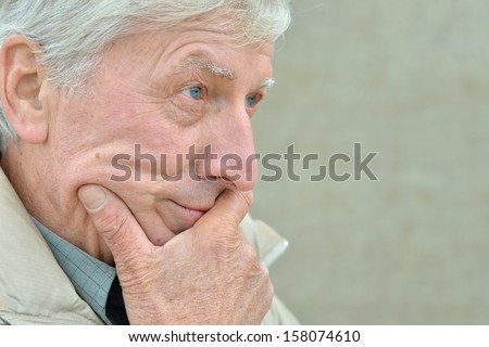 Attractive elderly man on a walk in autumn