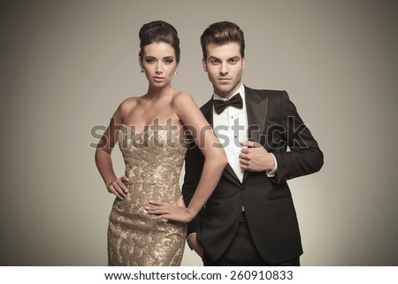 Formal dress stock images royalty free images vectors attractive elegant man fixing his jacket while his lover is holding her hand around her waist altavistaventures Images