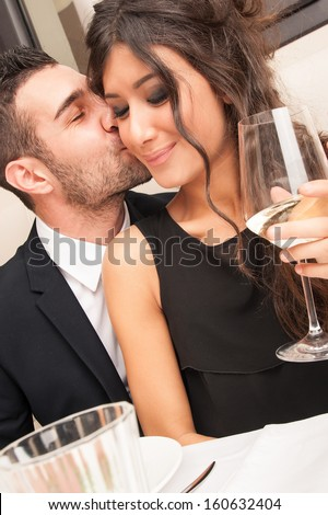 Attractive elegant young couple dating at the restaurant. - stock photo