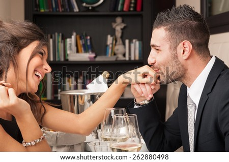 Attractive elegant young couple having romantic dinner at the restaurant.  - stock photo
