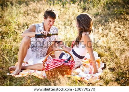 Attractive enamoured couple in picnic - stock photo