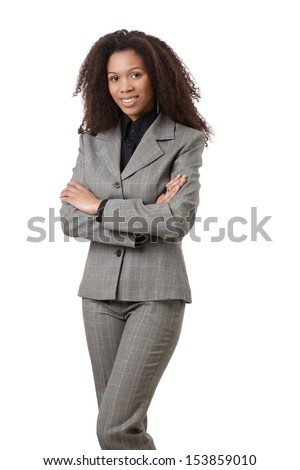 Attractive ethnic businesswoman standing arms crossed, smiling. - stock photo