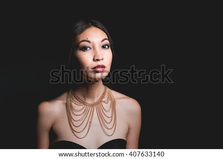 Attractive ethno middle eastern young woman alluring in sexual bra and necklace. - stock photo