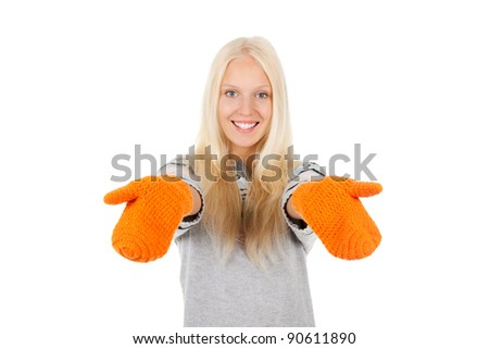 attractive excited happy smile woman looking at camera holding hands, wear winter knitted sweater and orange gloves, isolated over white background - stock photo