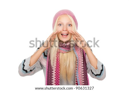 attractive excited smile woman looking at camera holding hands on mouth loud screaming or calling out to someone, wear winter knitted pink hat scarf and sweater, isolated over white background - stock photo