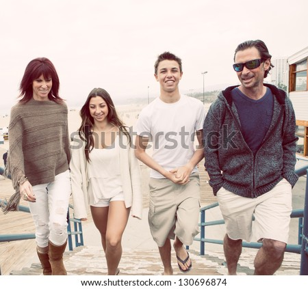 Attractive Family walking up to the pier in Santa Monica California - stock photo