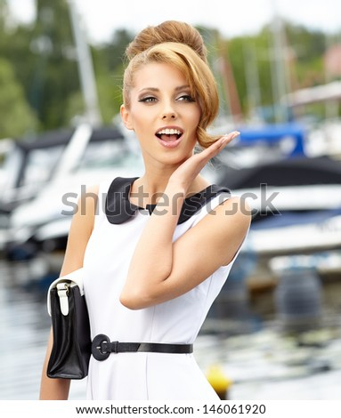 attractive fashion girl on the dock with boat