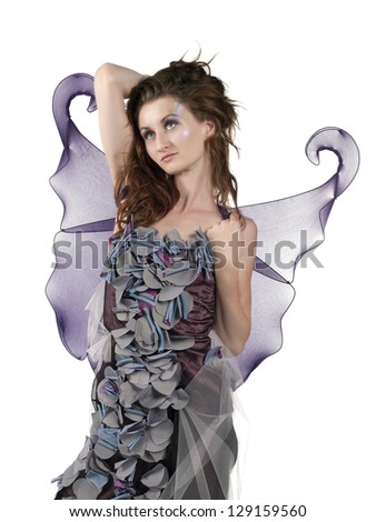Attractive fashion model posing as fairy on white background - stock photo