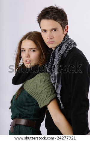 attractive fashion models as couple holding and looking at the camera isolated on white - stock photo