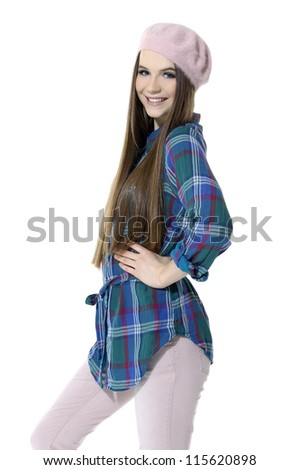 attractive fashionable girl in cap posing in studio.