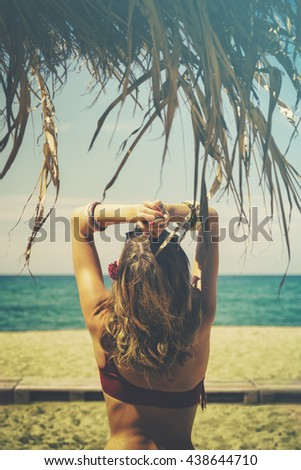 Attractive fashionable woman enjoying on the beach.