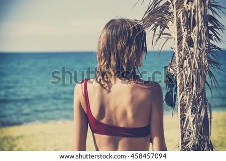 Attractive fashionable woman having fun on the beach.  - stock photo