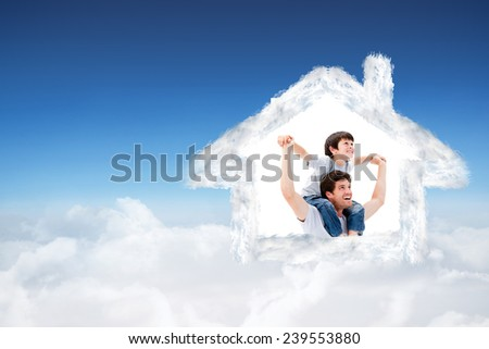 Attractive father giving a piggyback to his son against blue sky over clouds - stock photo