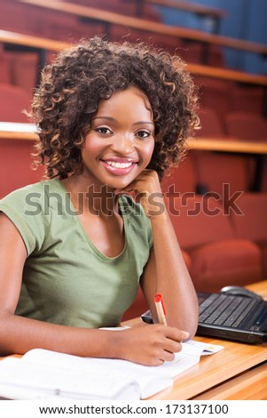 attractive female african american university student studying - stock photo