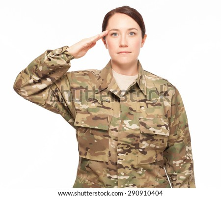 Attractive female Army soldier saluting while wearing multicam camouflage on white background. - stock photo