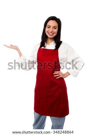Attractive female baker posing - stock photo