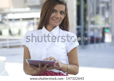 Attractive female business executive busy working on digital tablet