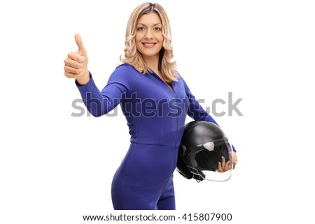 Attractive female car racer holding a helmet and giving a thumb up isolated on white background - stock photo