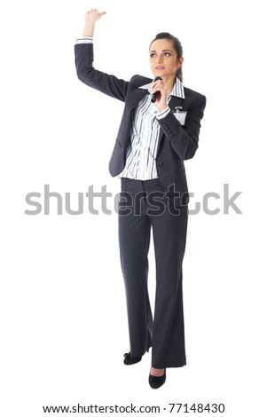 attractive female conference speaker during presentation, holds microphone and makes some gestures, full body shoot, isolated on white - stock photo