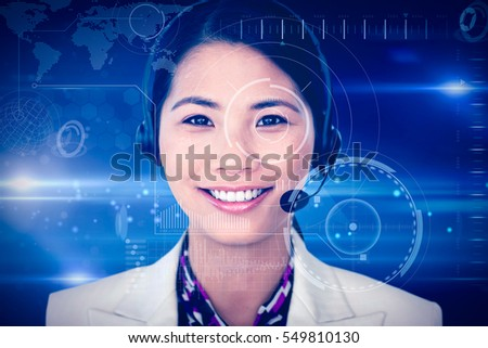 Attractive female engineer smiling at the camera against black and grey interface