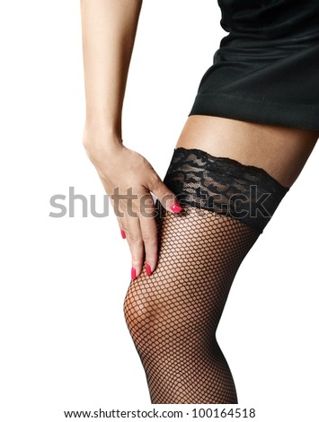 Attractive female legs in black stockings - stock photo