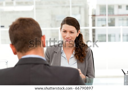 Attractive female manager during a interview with a businessman in her office