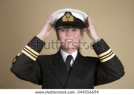 Attractive female naval officer holding her uniform hat