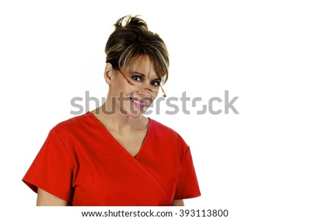 Attractive Female Nurse wearing red scrub top isolated on white background - stock photo