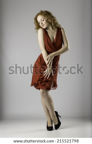Attractive Female Posing in Red Dress