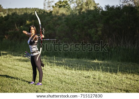Attractive Female Practicing Archery At The Range