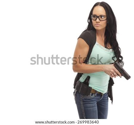 Attractive female shooter holding handgun against white background - stock photo
