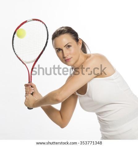 Attractive female tennis player holding the raquet with two hands