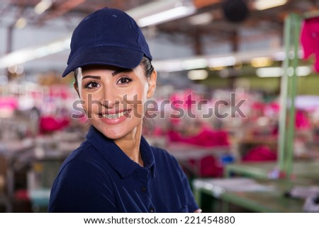 attractive female textile worker portrait in factory