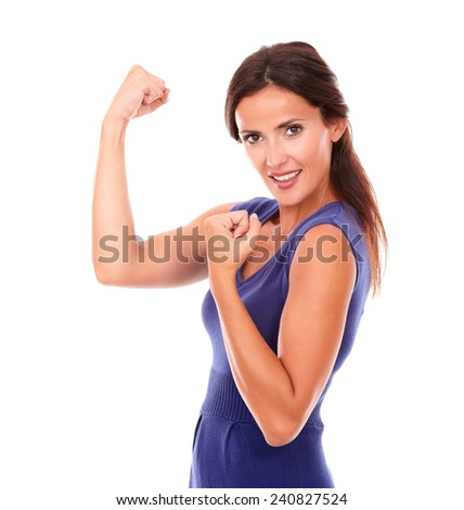 Attractive female with arms up celebrating victory while smiling and looking at you in white background - stock photo