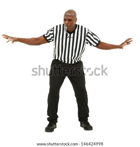 Attractive fit black man in referee uniform facing front and blowing whistle. - stock photo