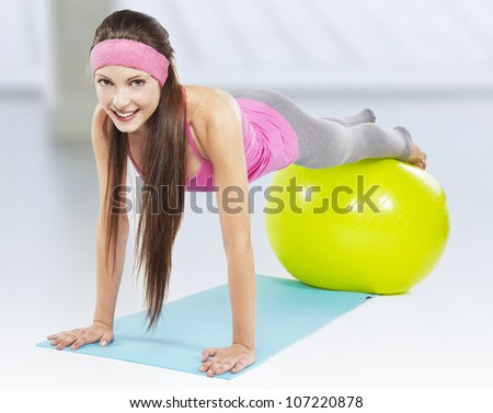 attractive fit woman pilates exercise isolated - stock photo