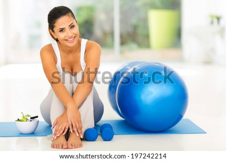 attractive fit woman with exercise ball at home - stock photo